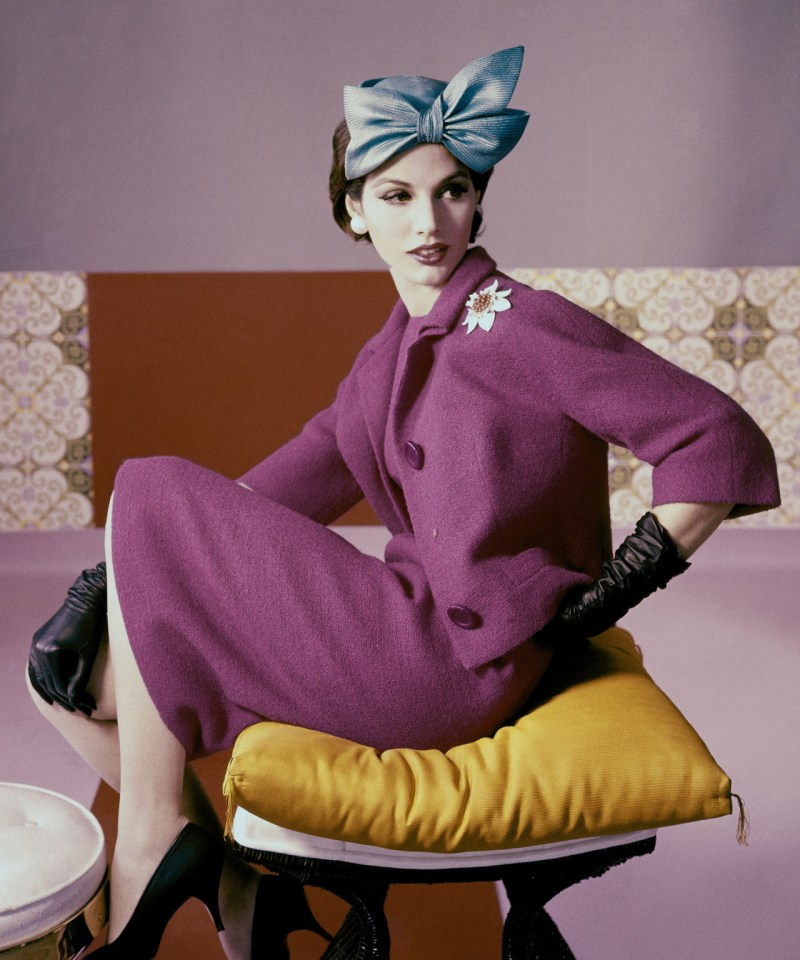 a-model-wears-a-fuchsia-dress-suit-and-hat-with-bow-detail-by-emme-1961